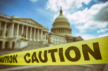 Caution tape running across the front of the US Capitol Building in Washington DC