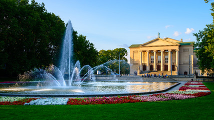 Deurstickers Theater Grand Theatre - neoclassical opera house located in Poznań, Poland - in the rays of the setting sun