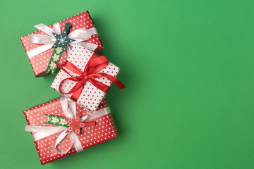 Christmas Background Three Christmas Gift Boxes Green Background Holiday Concept Flat Lay Copy Space