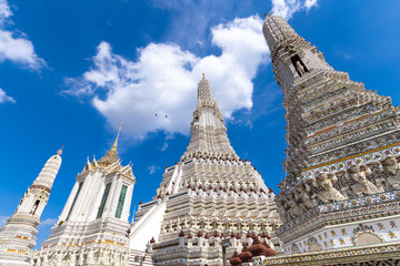 Wall Mural - The pagoda inside Wat Arun temple during beautiful blue sky with cloud in Bangkok, Thailand.