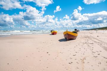 Colorful fishing boat on sandy beach in Debki village. Debki is a very popular holiday destination in Poland.