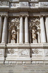 Baroque, white architecture with ancient statues and columns background in a sunny day in Italy