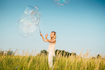 Very large soap bubbles. Soap show on the background of nature
