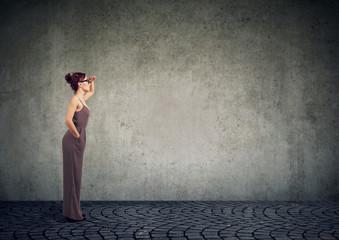 Modern woman looking far away