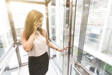 woman pressing elevator button. finger presses elevator button. businessman in lift