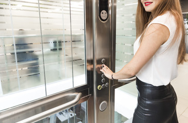 woman pressing elevator button. finger presses elevator button. businessman in lift
