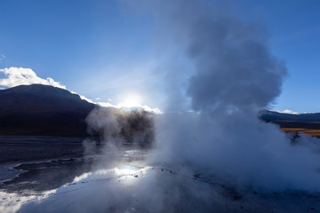Steam clouds rising at dawn in the El Tatio geyser field,  Atacama desert in the Andes Mountains, Chile