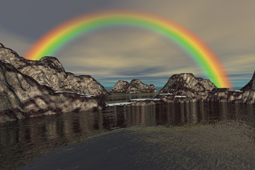 At the beach, a natural landscape, beautiful rainbow, ice on the rocks and a cloudy sky.