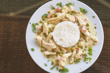 Thai dish chicken in curry sauce with rice