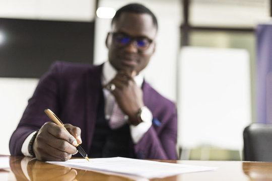 African american man signing contract, black man hand putting signature on official document, biracial clients customers couple make purchase or sign prenuptial agreement concept
