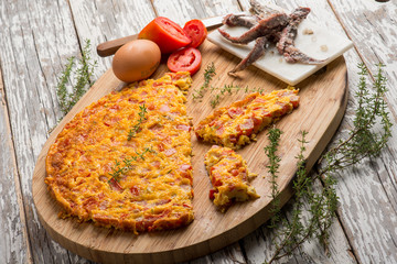 omelette with tomatoes anchovies and thymus
