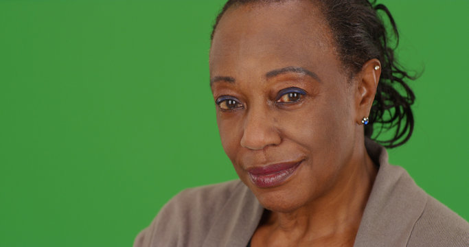 Close-up portrait of an elderly African American woman on green screen