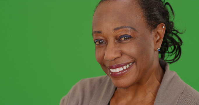 Close-up of a smiling elderly African American woman on green screen