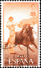 Bullfighter and bull on spanish postage stamp