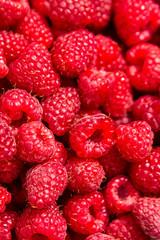 Fresh red ripe raspberries as background, closeup