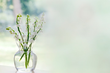 Wall Murals Lily of the valley Bouquet of lily of the valley blossoms; soft light illuminating the delicate flowers for a clean fresh look.