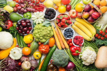 Healthy fruits vegetables berries background, cherries peaches strawberries cabbage broccoli cauliflower squash tomatoes carrots bananas beans beetroot, pepper, top view, selective focus