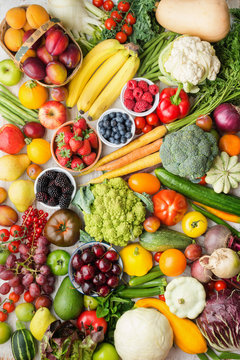 Healthy fruits vegetables berries background, cherries peaches strawberries cabbage broccoli cauliflower squash tomatoes carrots bananas beans beetroot, pepper, top view, vertical, selective focus