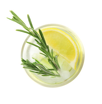 Glass of refreshing lemon cocktail with rosemary on white background, top view