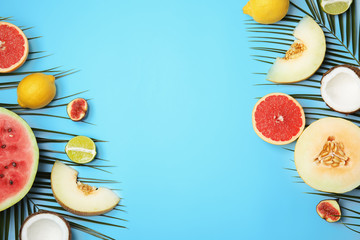 Flat lay composition with melon, other fruits and space for text on color background