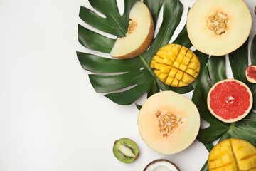 Flat lay composition with melon, other fruits and space for text on white background