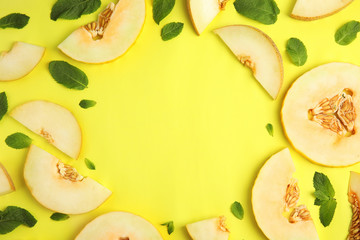 Frame made of melon and mint leaves with space for text on color background, top view