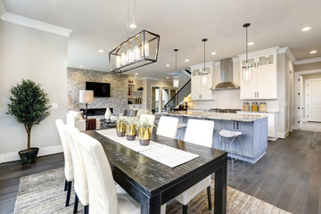 Beautiful kitchen in luxury modern contemporary home interior with island and chairs Wall mural