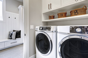 White clean laundry modern room with washer and dryer