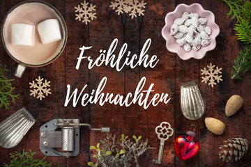 """weihnachtlich Dekoration und Nachricht """"Fröhliche Weihnachten"""" auf rustikalem Holzuntergrund"""