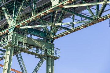Halifax, closeup, bridge, steel, girders, metal, green, blue sky.