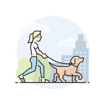 Blond woman walking yellow Labrador Retriever dog