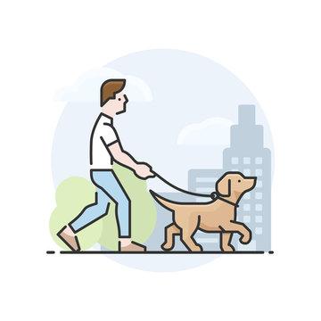 Man walking a yellow Labrador Retriever dog