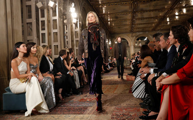 A model presents a collection at Ralph Lauren's 50th anniversary fashion event during New York Fashion Week in New York