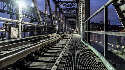 Pattullo Bridge, Surrey, British Columbia, Canada. Long exposure of the bridge over the water.