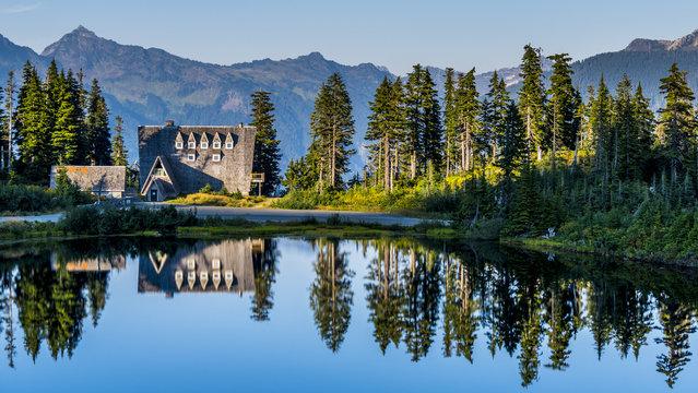 Pristine lodge mirroring in a lake at Mount Baker, Washington - USA.