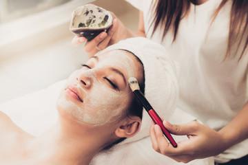 Beautiful woman having a facial treatment at spa.