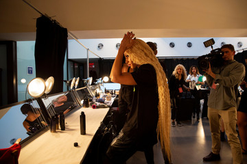 Designer Phillipe Blond styles his hair backstage before The Blonds Spring/Summer 2019 collection during New York Fashion Week
