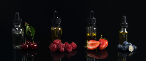 four flavor flavors, in glass containers, on a black background, with a taste of cherries, strawberries, raspberries, blueberries, with reflection