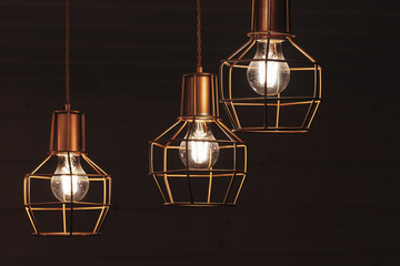 Chandelier with hanging three bulb LED lamps