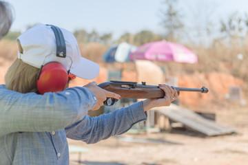 Beautiful young Asian practice shooting outdoor