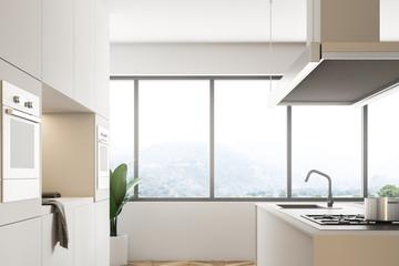 White kitchen corner with island side view