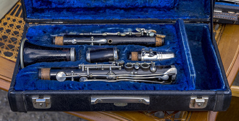 Old clarinet in blue lined case