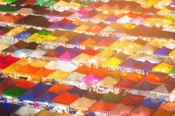 Night market roof top multiple colour, cityscape background