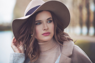 Beautiful brunette woman outdoor, lifestyle portrait