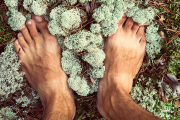 bare feet on moss in the forest