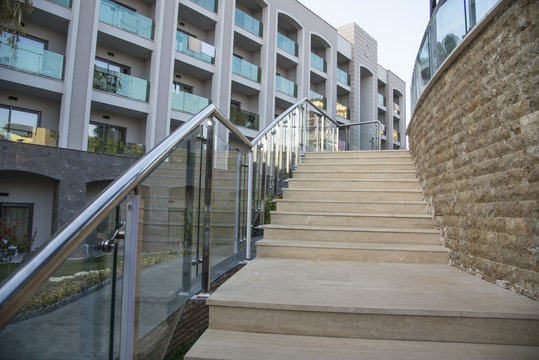 Outdoor stone staircase. Stone steps of old staircase with stainless steel
