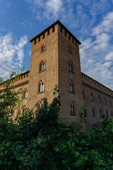 The facade of the Visconti Castle ( castello visconteo ). Medieval building with red brick facades in Pavia, Lombardy, Italy