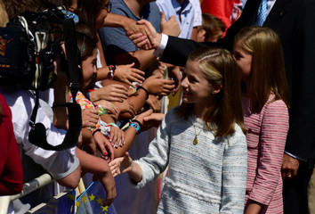 Spain's Princess Leonor gestures during the performances marking the occasion of the Centenary of the Catholic Coronation of the Virgin of Covadonga outside the Basilica of Covadonga in Cangas de Onis