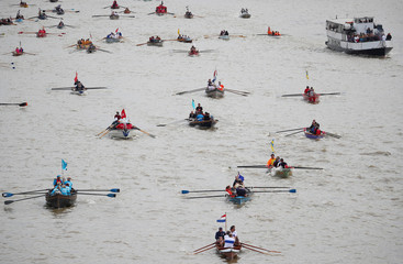 Rowers take part in the Great River Race on the River Thames in London