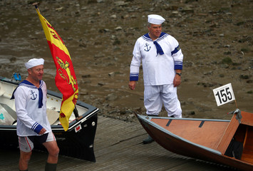 Rowers prepare to participate in the Great River Race on the River Thames in London